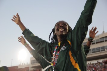 A member of the South African team relishes in the her moment of fame during the Special Olympics World Games Opening Ceremony on Saturday.
