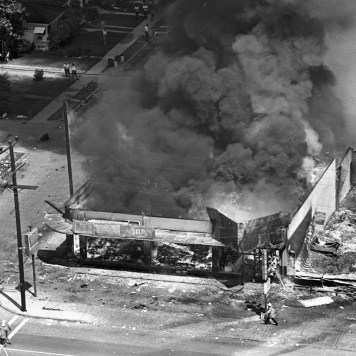 Aug. 13, 1965: Building burns at 107th St. and Avalon Blvd. during Watts Riots. This photo was published in the Aug. 14, 1965 Los Angeles Times.