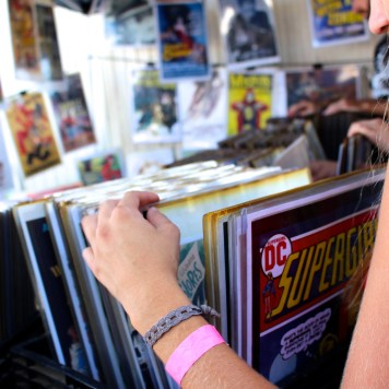 Peering at collectible posters