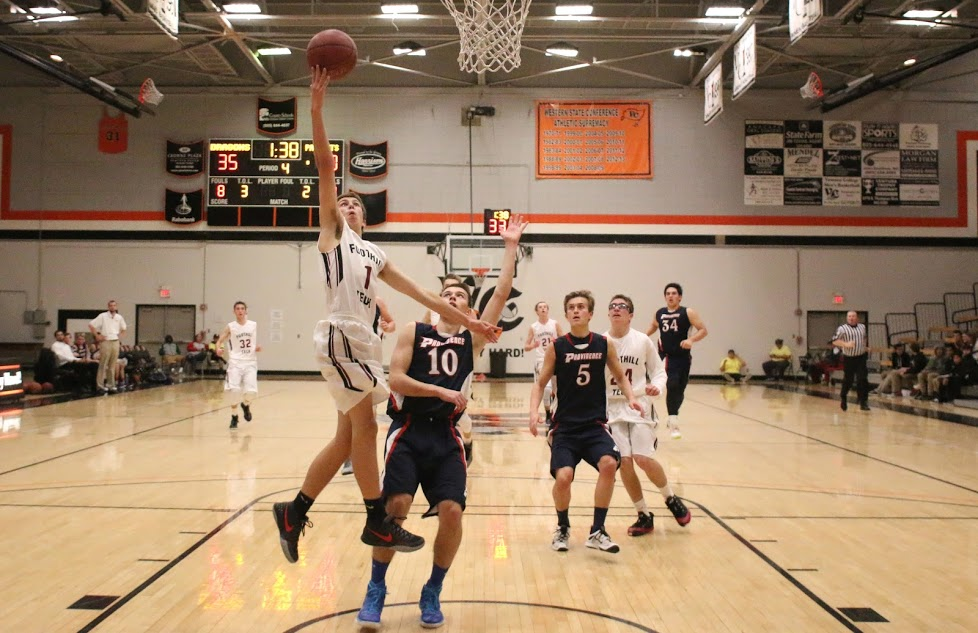 Boys' basketball falls to Providence High School in first home game of the season, 50-44