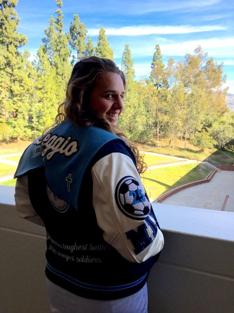 Nicole Leggio shows off her soccer letterman jacket, which displays her favorite quote.