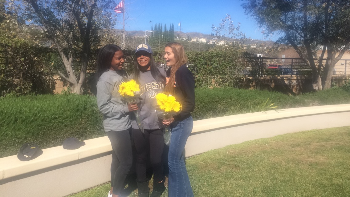 Taylor Hobson (Center), one of the older sisters of Bailey Hobson, poses for pictures with her sister and Shaffer