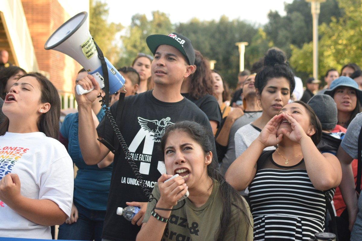 Outside of the rally, a decent-sized group of UCR students organized an anti-Hillary protest, criticizing her for being in bed with Wall Street and her involvement in bringing the US into the Iraq War.