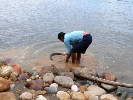 Here is someone panning for gold in the river.
