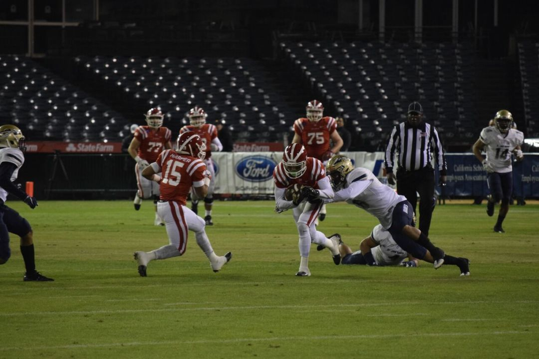 Mater Dei received the ball on their own 25 yard line and began pushing through Bosco's line. Photograph by Dylan Stewart