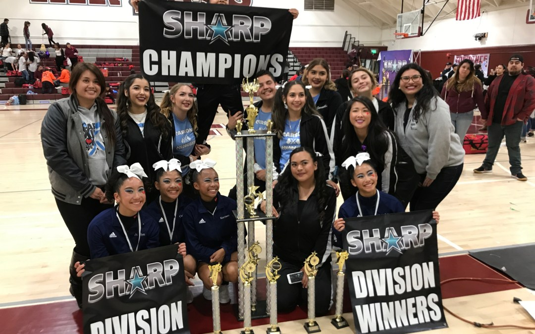 Carson wins First Place Sharp Champions