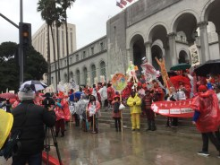 UTLA Members on the steps of City Hall chanting in the rain.