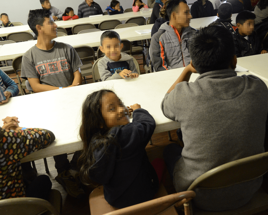 Recently-arrived Migrant Children Smile at the Camera