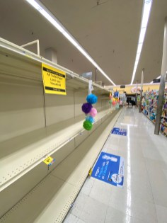 Usually full: Panicking stockpilers strip the shelves of paper products as multiple months of quarantine loom ahead. Store shelves, usually stocked with toilet paper, sit bare as a limit per household is set at this local store. (Photo by Sophie Robson)