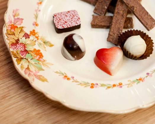 Selection of individual praline chocolates and Honeycomb sticks.