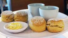 Scones served with cream, butter and mixed berry jam