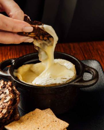 Baked Normandy Camembert au Calvados served with lavosh - supplied photo