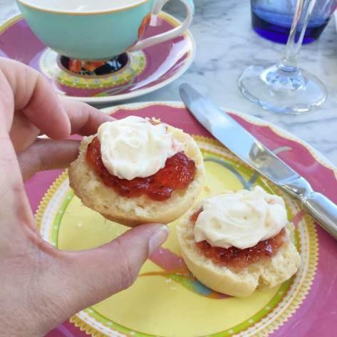 Scones with vanilla bean cream and strawberry jam