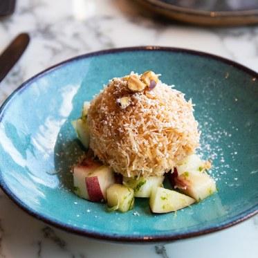 Lemon myrtle cheesecake & crispy kataifi pastry served with fresh fruit salad