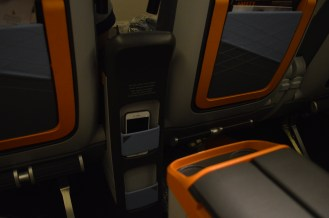 Ample storage, including cocktail tray, small storage in the seat in front, laptop storage in the seat pocket and water bottle holders at the base of the seat