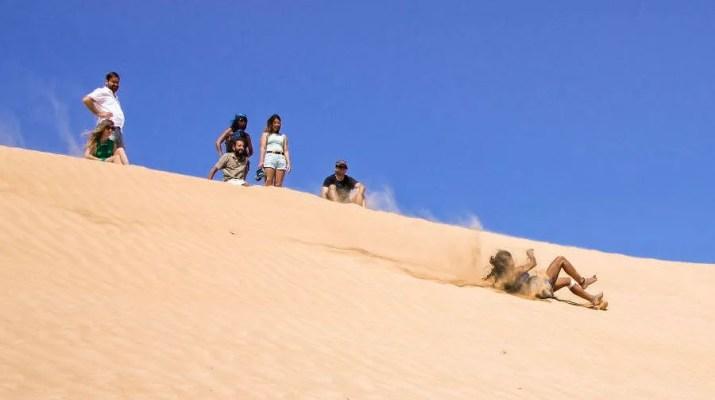 Sliding on the sand dune, Negev desert, Israel
