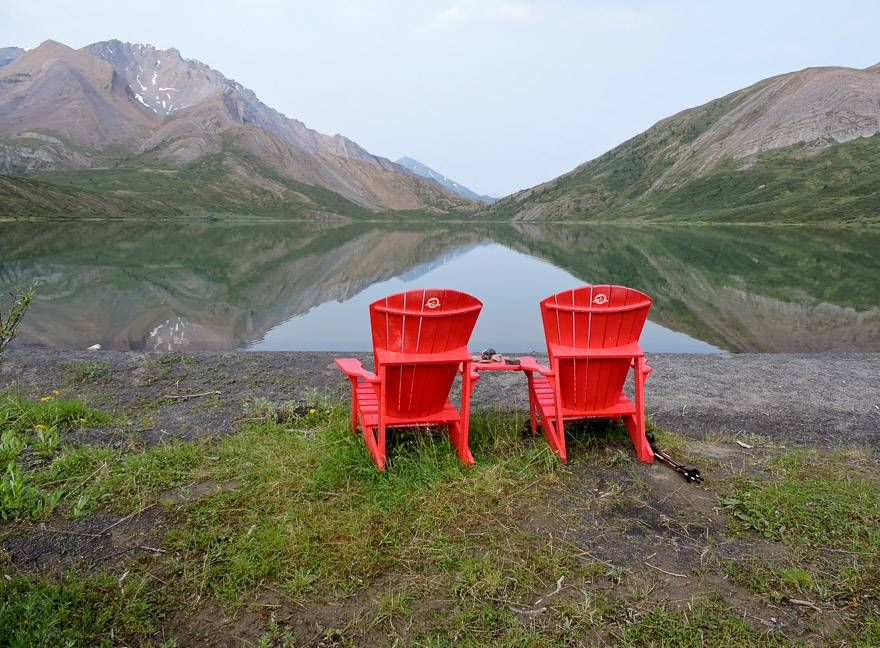 The signature Parks Canada chairs overlook Backbone Lake at Nááts'įhch'oh National Park Reserve. Photo courtesy: Marlis Butcher