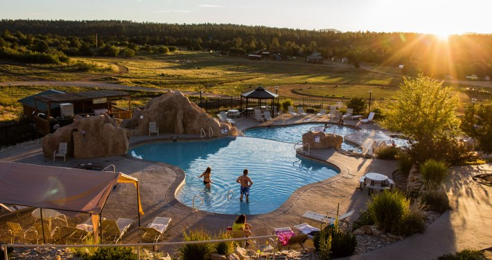 a couple in the swimming pool of the Zion Ponderosa Ranch Resort in St. George, Utah
