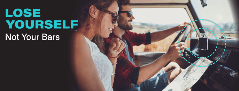 couple reading a map inside a car