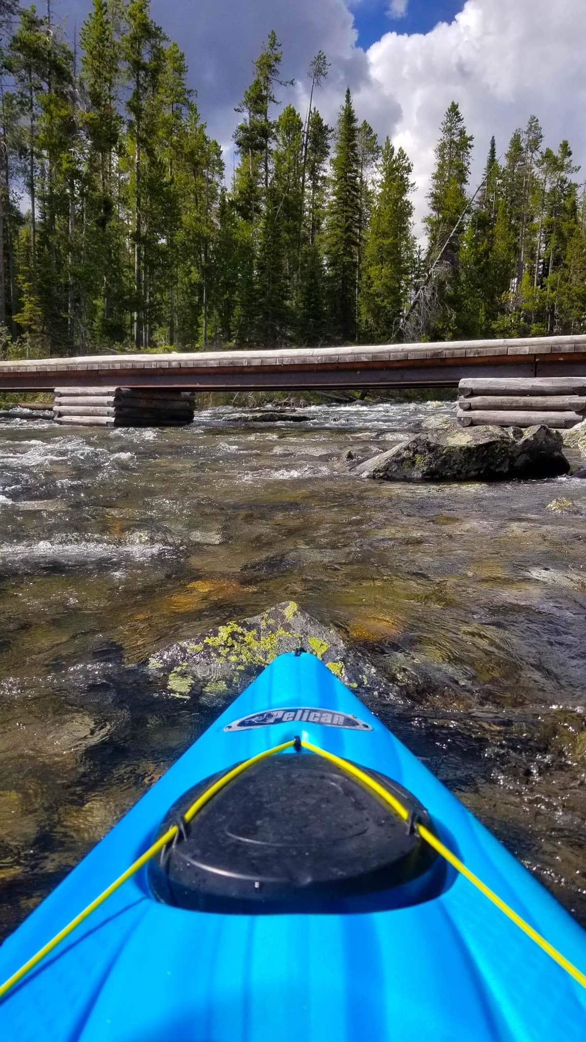 Kayaking String Lake at bridge between Leigh Lake and String Lake