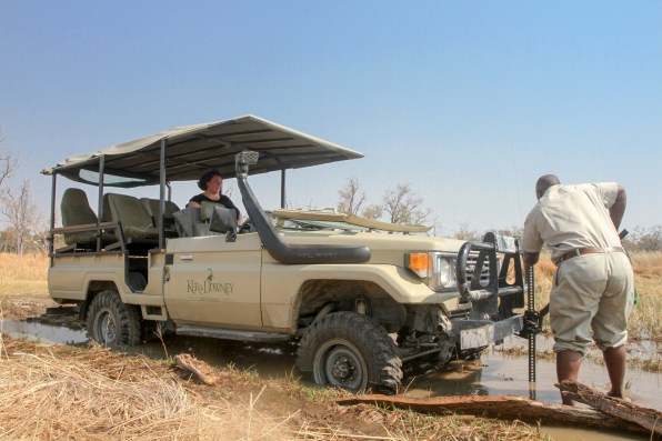 Land cruiser stuck in the mud as we head to the airstrip for the flight to out next camp