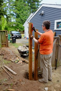 Jon leveling two side by side posts