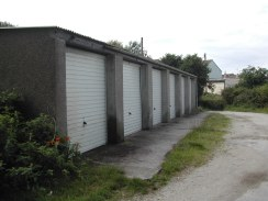 A terraced row of garages in St Agnes