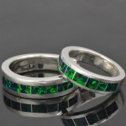 His and hers lab created opal wedding ring set.