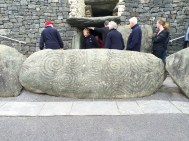 Exiting the Newgrange tomb, decorated kerbstone