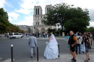 Bride walking to Notre Dame