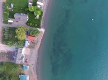 Drone photo of cabin and paddle boat