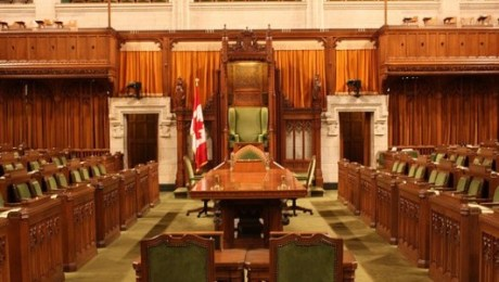 Image of Canadian House of Commons, Speakers Chair at far end.