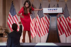 Kimberly Guilfoyle bends over on stage.