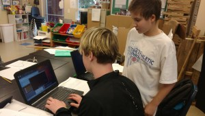 Students work in teams to do inquiry based research.