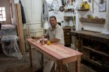 This is José who hosts us in his carpenter workshop.