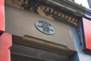 Plaque at entrance to Shrub Mount