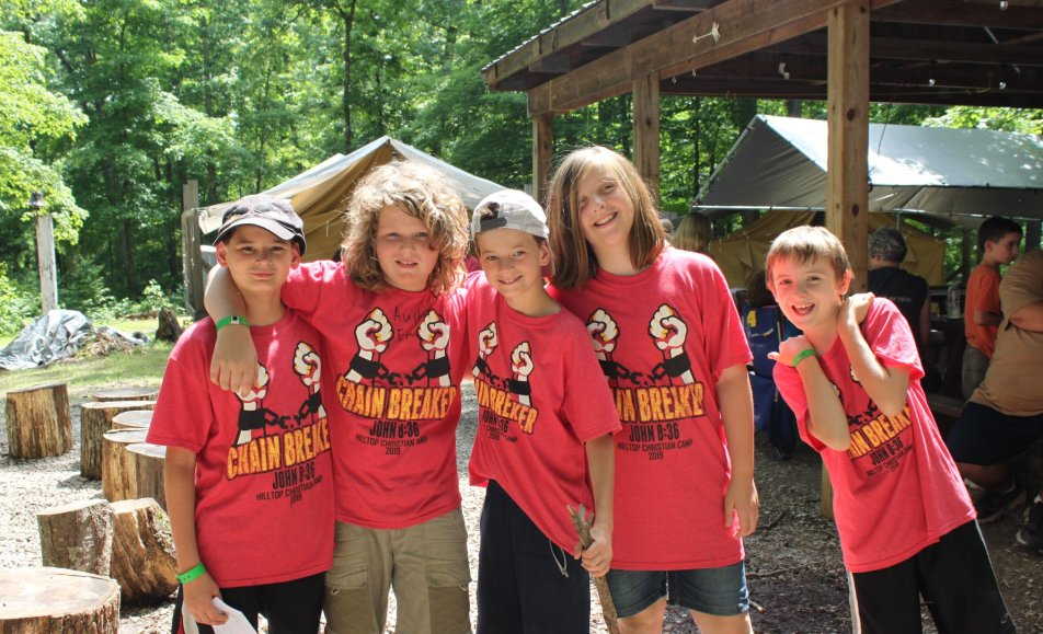 Young boys wearing camp t-shirts outside
