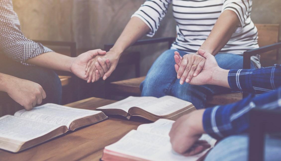 Women praying at Bible study
