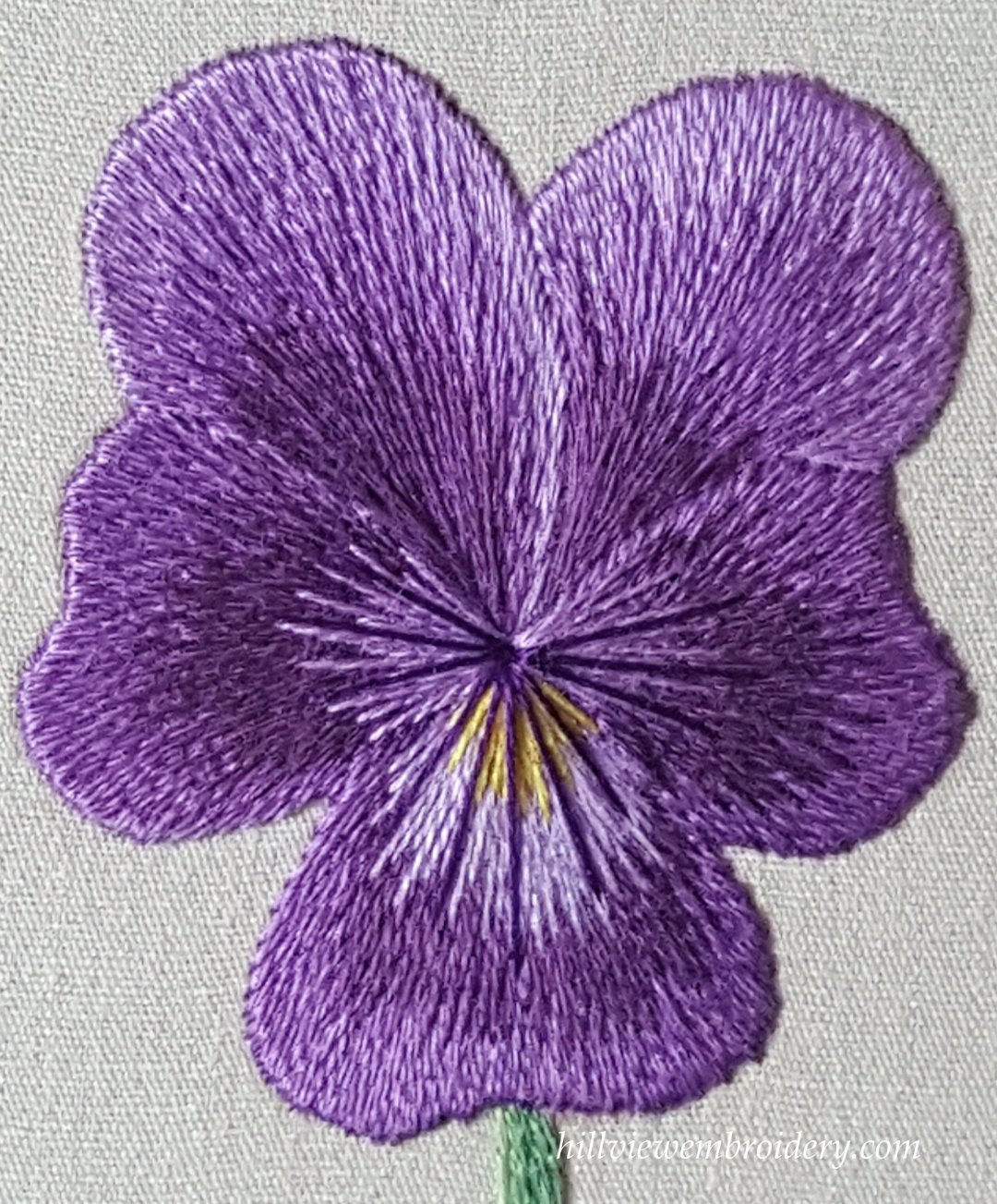 A pansy stitched in silk shading