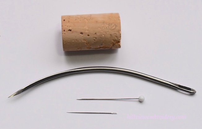 A bracing needle used for framing up slate frames size comparison