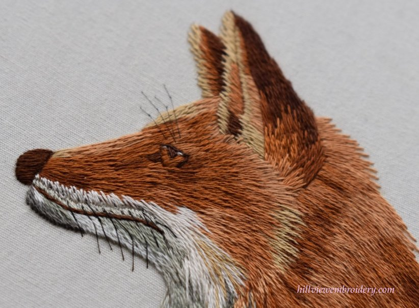 A fox's face stitched in the technique of silk shading