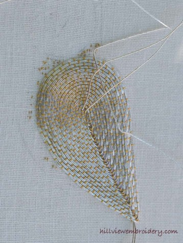 a look at a gold work technique of couching before threads are plunged