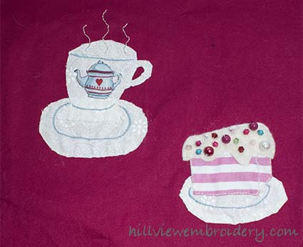 A gift stitched with friends! An appliquéd tea cup and cake