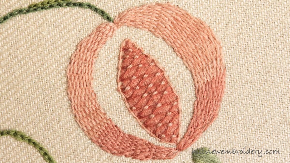 pomegranate worked in burden stitch