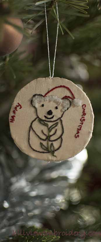 hand embroidered Christmas koala ornament, designed and stitched by Catherine Patterson