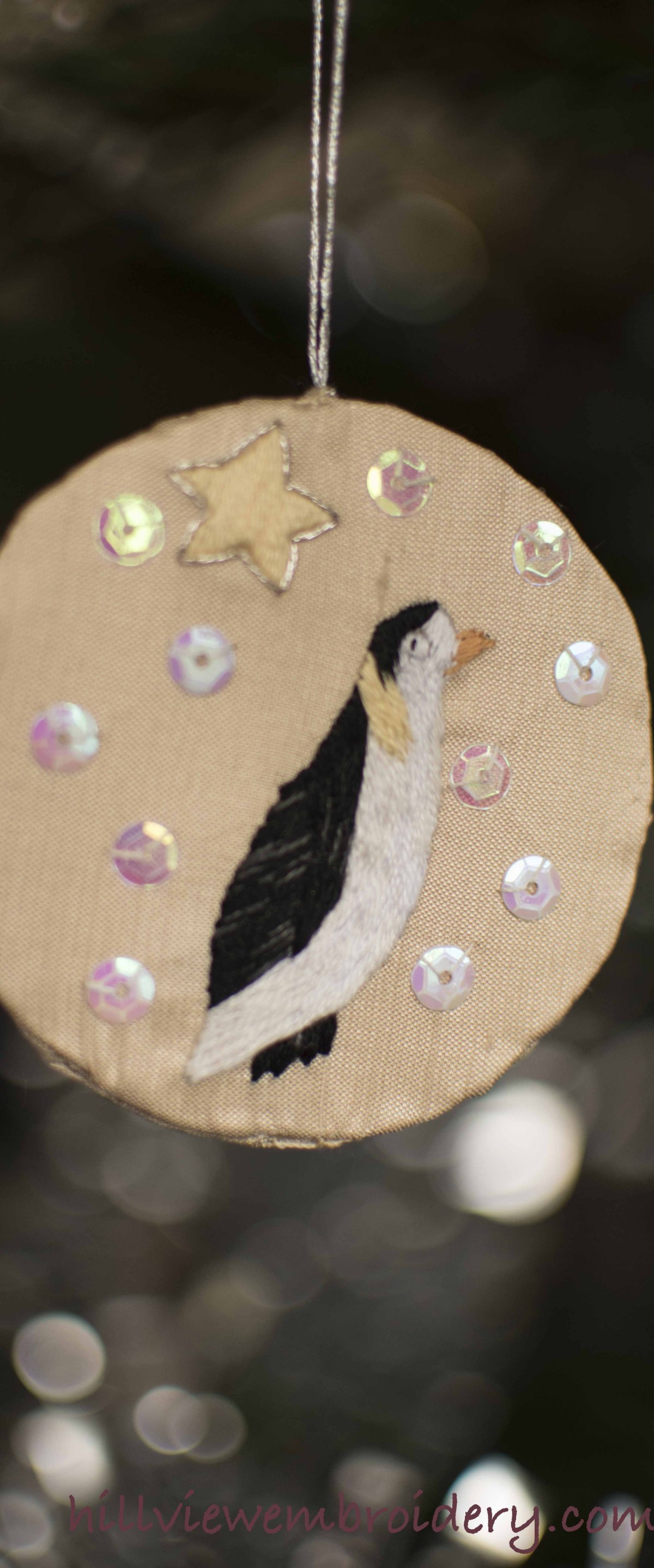 hand embroidered Christmas penguin ornament, designed and stitched by Catherine Patterson