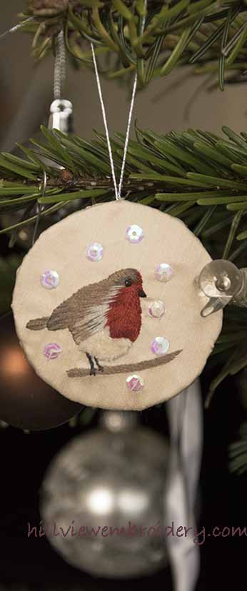 hand embroidered Christmas robin ornament, designed and stitched by Catherine Patterson