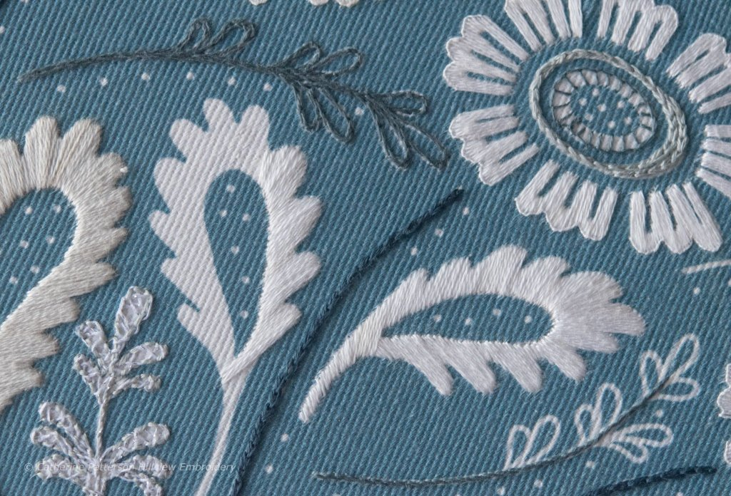 Detail of progress on Anne's Orchard clutch stitched by Catherine of Hillview Embroidery