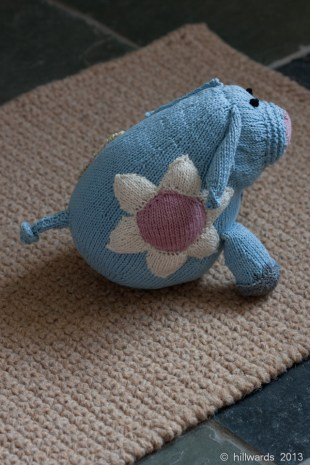 Rosie Pig side view - knitted soft toy in Rowan Purelife organic cotton DK.