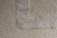 Detail of reverse stocking stitch on diagonal garter stitch